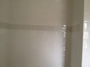 Penny tile stripe from shower