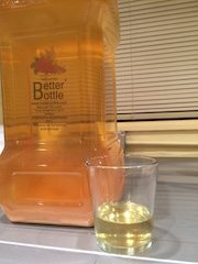 The finished cider, with a glass showing how clear it is.